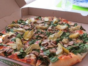 Large pizza with spinach, artichokes and mushrooms from Pizzaiolo