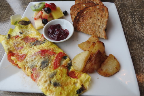 Omelette with mushrooms, tomato, Swiss cheese and spinach at Beach Hill Restaurant, Toronto