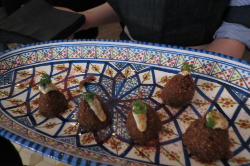 Duck kibbeh with dried fig, tahini and date molasses at Byblos Restaurant in Toronto