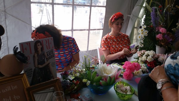 Getting flowers arranged for our hair at the Flare tent at Hats & Horseshoes Party