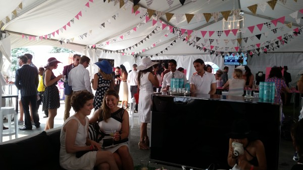 Guests mingled inside the Flare tent at the Hats & Horseshoes Party