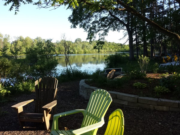 Muskoka chairs surround a firepit at Forest Motel, Stratford