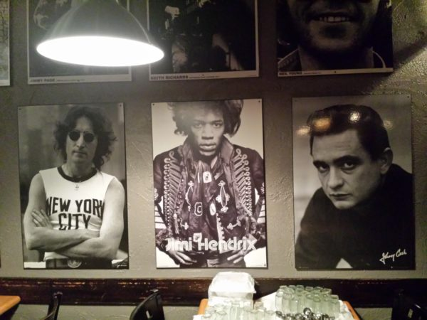 Posters of rock and country music icons cover the walls at Factory Girl, Danforth
