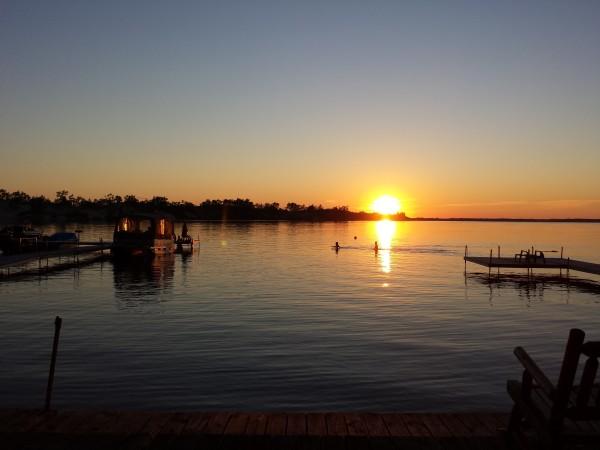 Sunset on West Lake at Sandbanks Beach Resort, Sand Dunes location