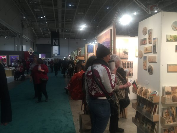 Visitors browse at the One of a Kind Craft Show 2016 in Toronto