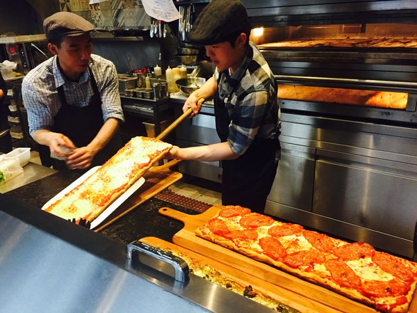 Fresh pizza made by staff at Tosto Quickfire Pizza Pasta
