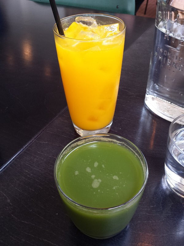 Freshly squeezed orange juice and Greenhouse Juice Co.'s cold-pressed juice at The Green Wood