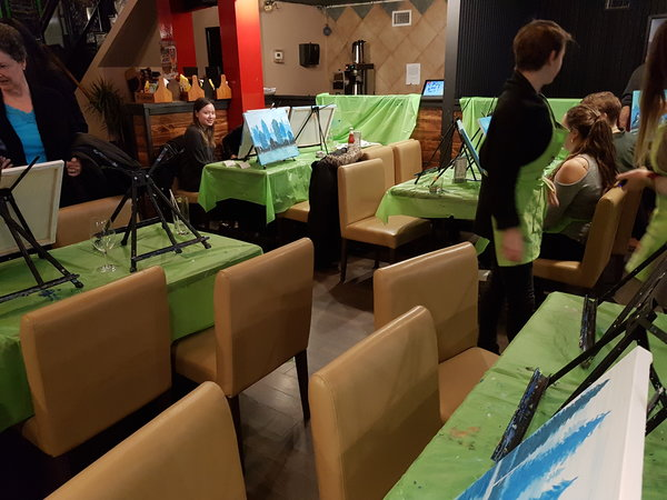 Paint stations set up for Paint Nite at Midtown Gastro Hub in Toronto.