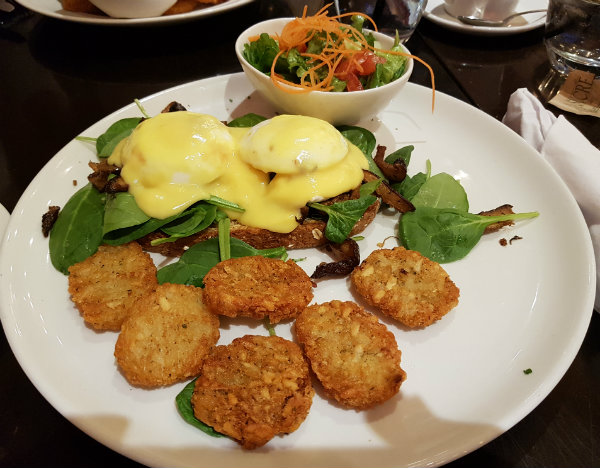 Three Mushroom and Fresh Spinach Benedict with potato pancakes and green salad at Green Eggplant Mediterranean Grill