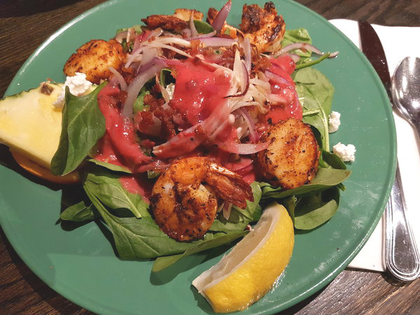 Bayou Spinach Salad with organic enoki mushrooms, smoked bacon, roasted pecans, shrimp, scallops and goat cheese at ViVetha Bistro in Toronto