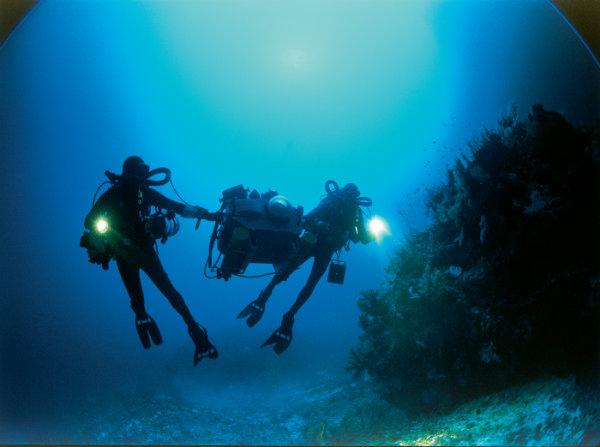 Howard Hall and crew member maneuver 250-pound IMAX camera in Fiji