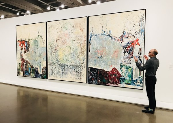 K. Brummel with large Triptych, 1964, Riopelle at Mitchelle Riopelle Nothing in Moderation at the AGO