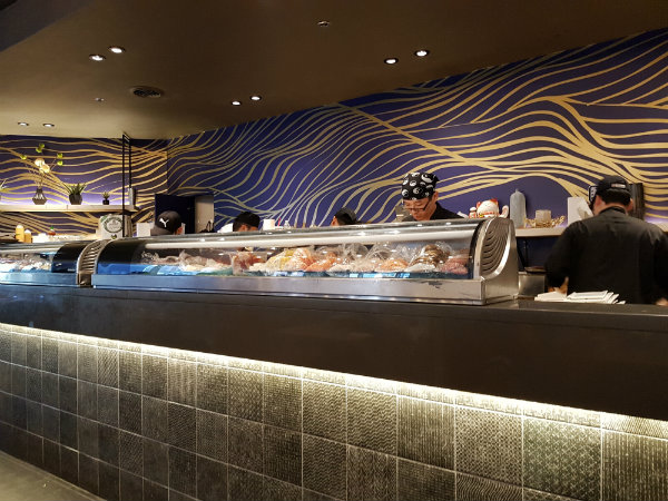 Chefs prepare sushi and other dishes at KaKa All You Can Eat in Toronto