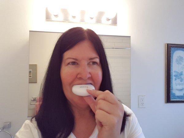 Applying the light to the Crest 3D White Whitestrips