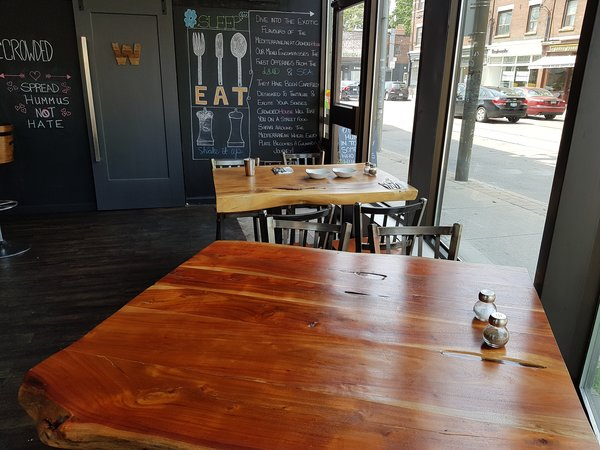Hand-carved tables at Crowded House