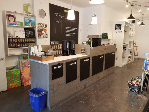 Coffee bar with complimentary premium roasted coffee and organic tea blends at Paintlounge Toronto East location.