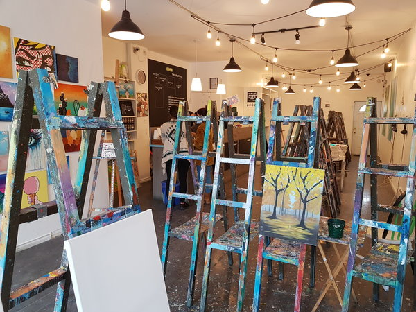 Easels are ready for participants at Paintlounge Toronto East location.