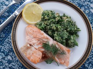 Salmon with cauliflower rice and spinach is a low carb meal.
