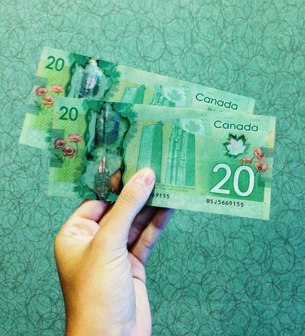Canadian dollars, photo credit Michelle Spollen on Unsplash
