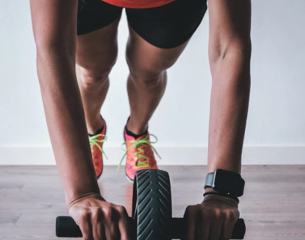Working out at home gym, photo by Tibout Maes on Unsplash