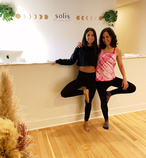 Diana hanging out with Laura, owner of Solis Movement