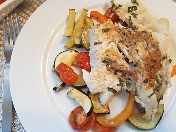 Baked Haddock with Sun-Dried Tomato Pesto, Zucchini and Orange Pepper is a delicious Keto dinner recipe.