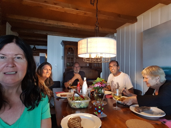 Enjoying dinner in dining room at cottage rental on Balsam Lake in the Kawarthas.