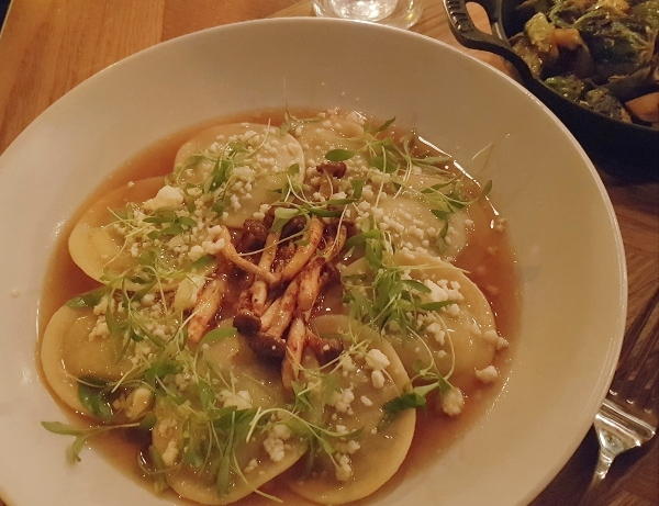 Ravioli Huitlacoche with Porcini and Portabello mushrooms, corn puree, chipotle beech mushrooms, queso fresco, cotija, porchini dashi and cilantro,