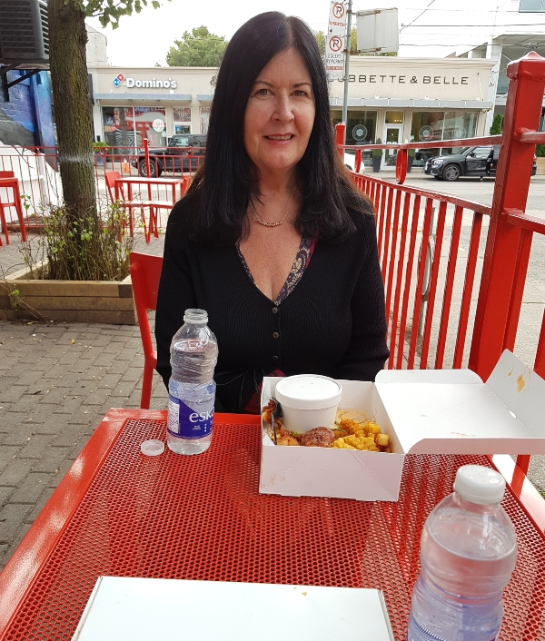 Sitting on the patio at Dave's Hot Chicken Leslieville enjoying my Combo #3.